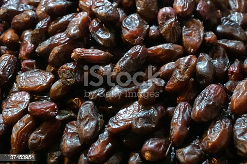 Phoenix dactylifera, commonly known as date or date palm, is a common and famous fruit item - being sold in old delhi market in the evening.