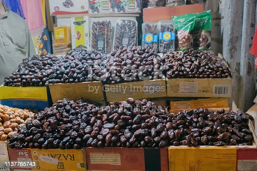 OLD MARKET, NEW DELHI, INDIA - OCTOBER 28 2018 : Phoenix dactylifera, commonly known as date or date palm, is a common and famous fruit item - being sold in old delhi market in the evening.