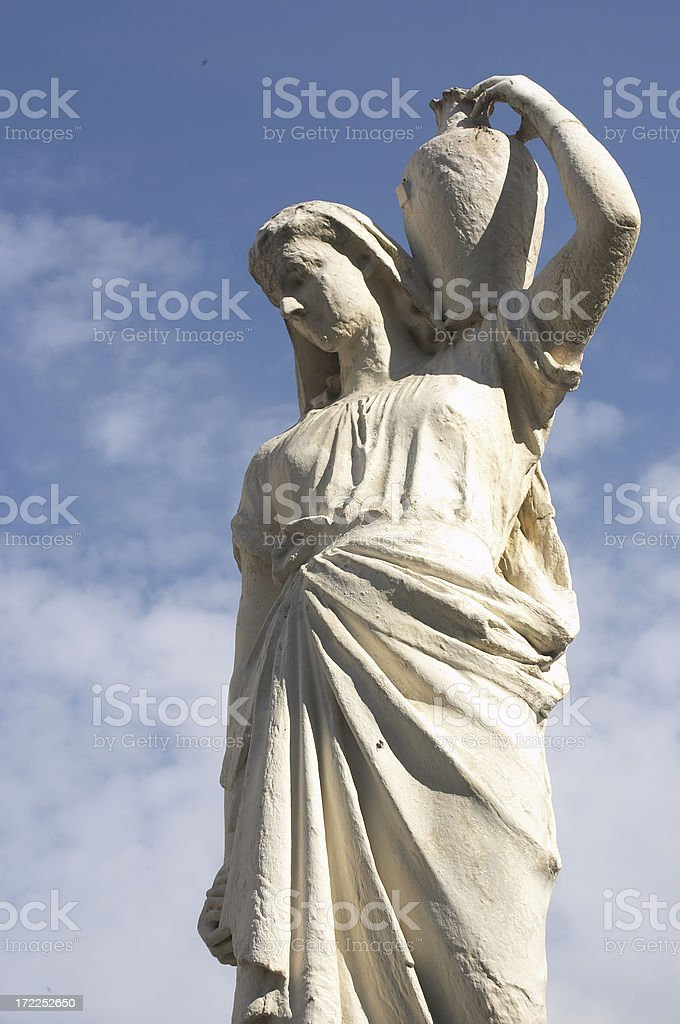 Water carrier statue of woman bearing stone vase stock photo
