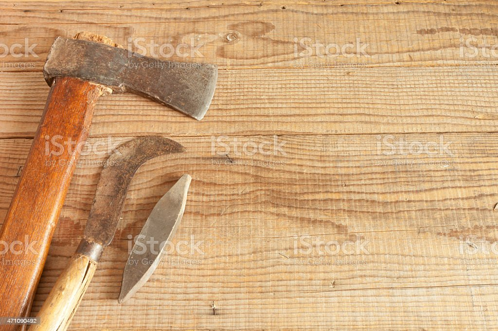 dated and used cleaver on wooden background stock photo
