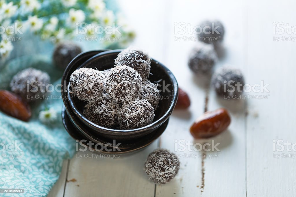 Dates and coconut energy balls stock photo