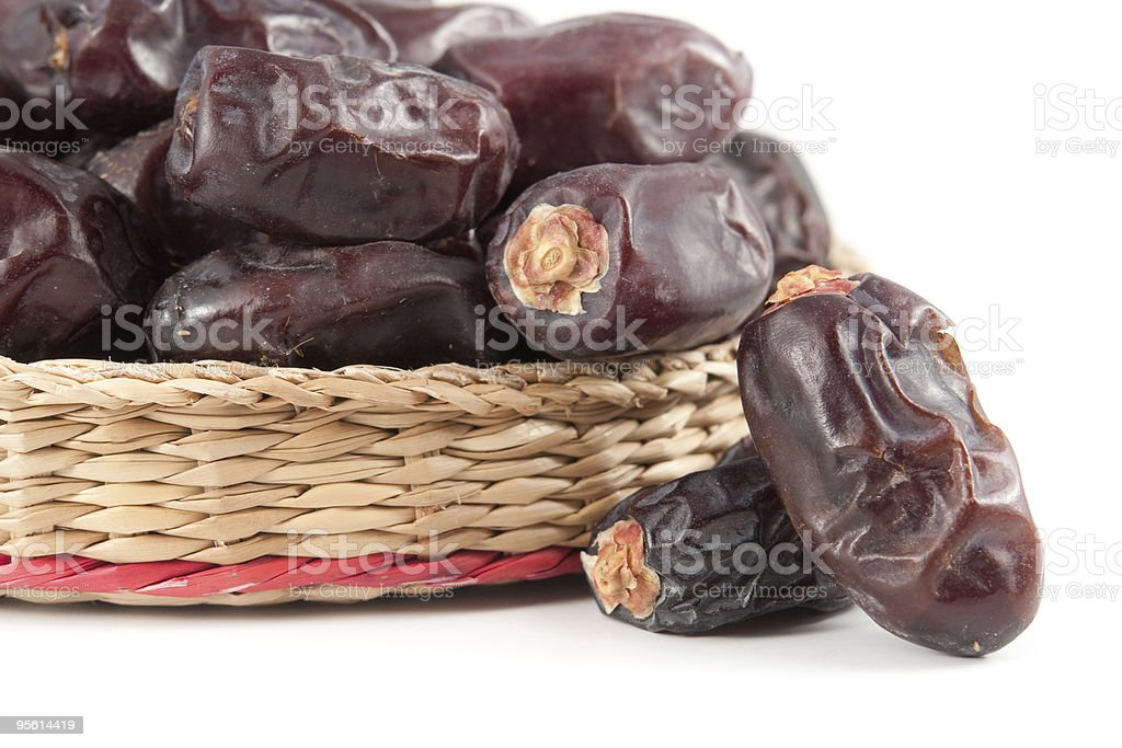 Dates fruits in basket - isolated on white stock photo