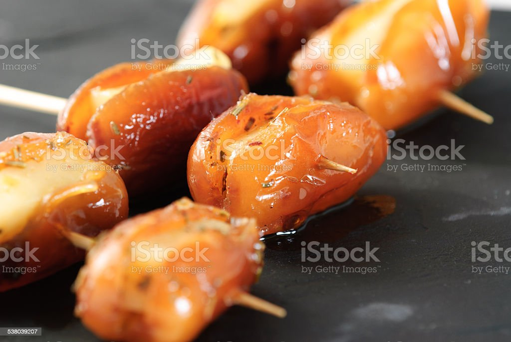 dates skewer with cheese stock photo