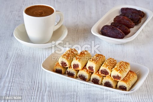 1200374148 istock photo Dates stuffed cookies with cup of turkish coffee . Close up 1184578039