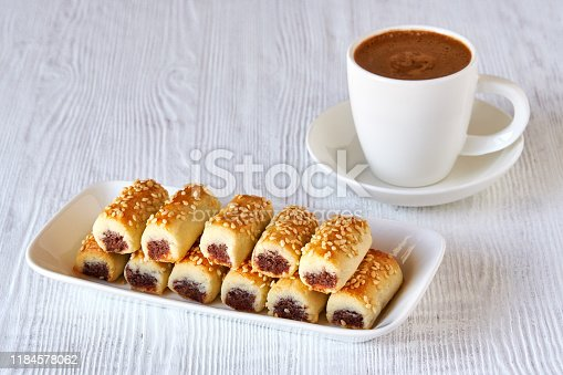 1200374148 istock photo Dates stuffed cookies with cup of turkish coffee . Close up 1184578062