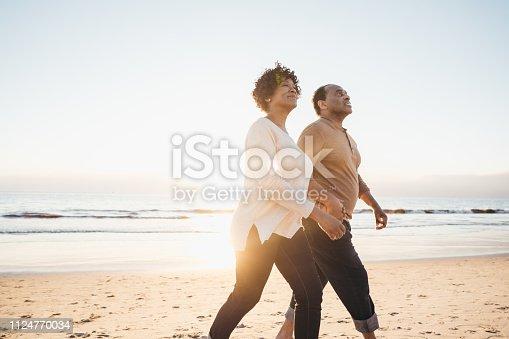 Senior couple walking by the seashore