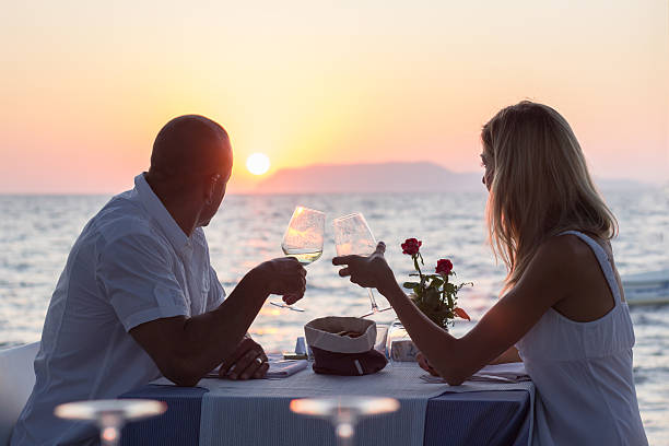 Dating couple drinking wine at sunset