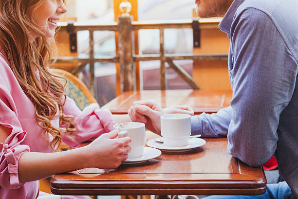 dating, couple in cafe - 談笑する ストックフォトと画像