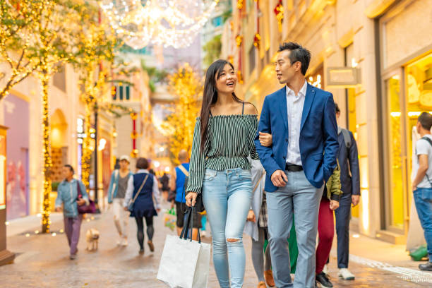 Dating Couple Shopping in Hong Kong Dating couple shopping in Hong Kong shopping couple asian stock pictures, royalty-free photos & images