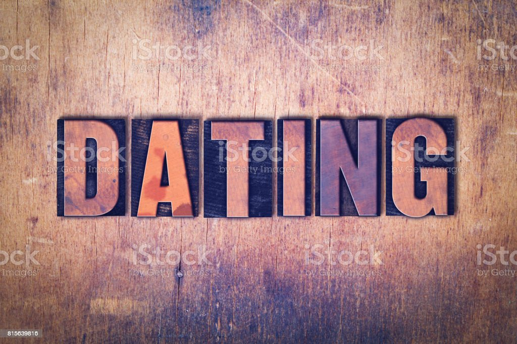 Dating Theme Letterpress Word on Wood Background stock photo