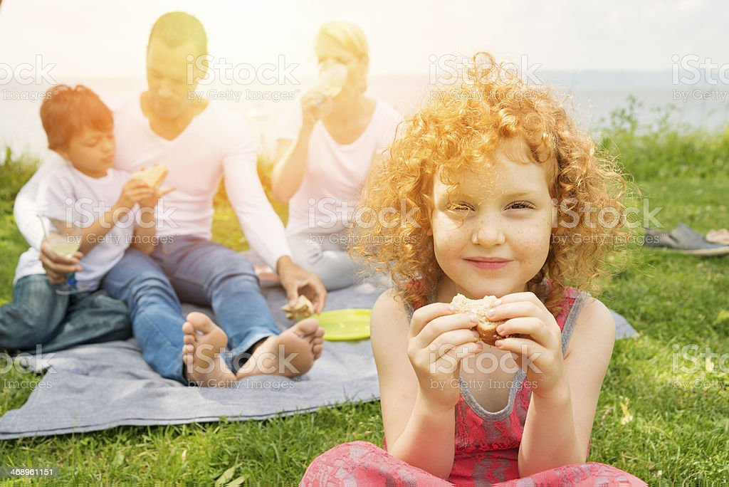 Dating with children, reconstituted family picnicking on riverside. stock photo
