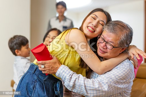 Daughter and Father Hugging for Chinese New Year