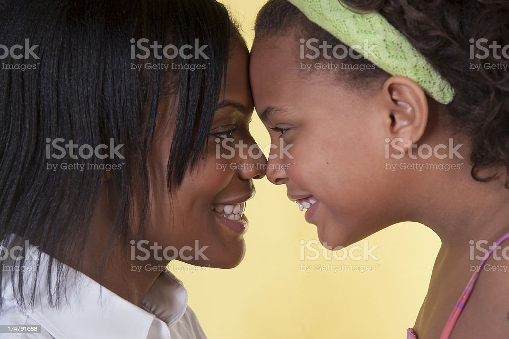 Daughter and mother face each other royalty-free stock photo