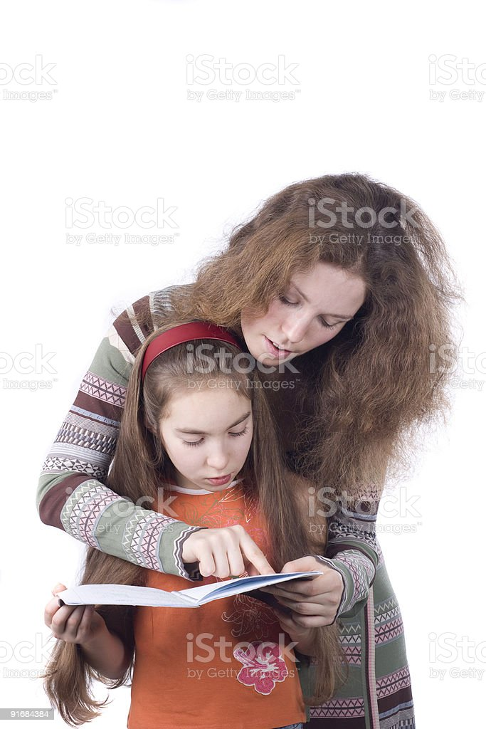 Daughter and mother learning together royalty-free stock photo