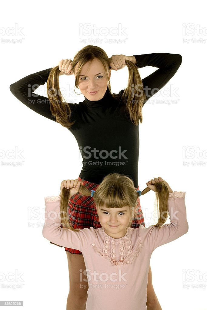 daughter and mother playing royalty-free stock photo