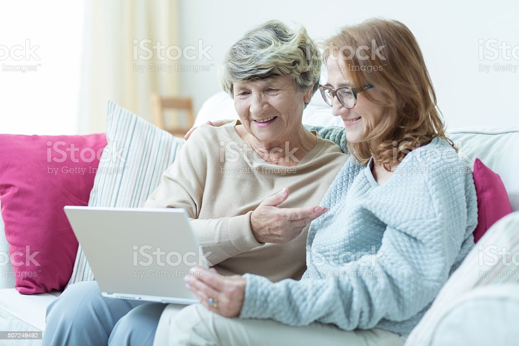 Daughter and mother with computer stock photo