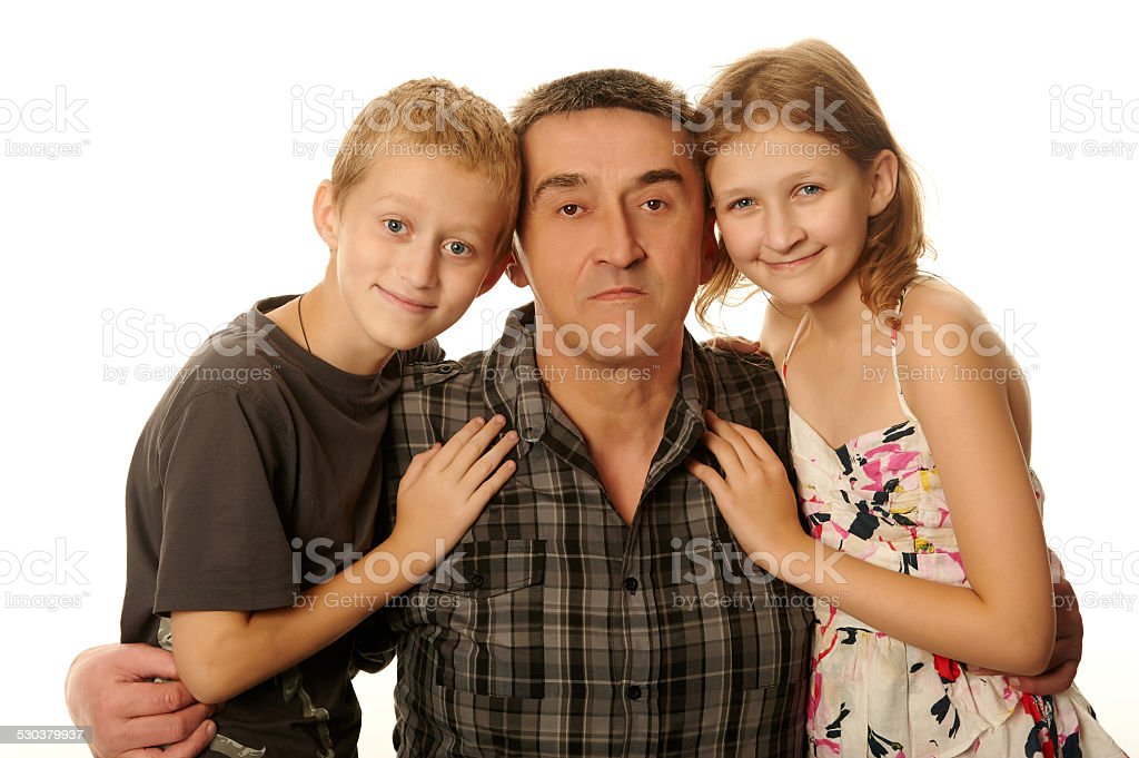 Daughter and son embraced his father stock photo