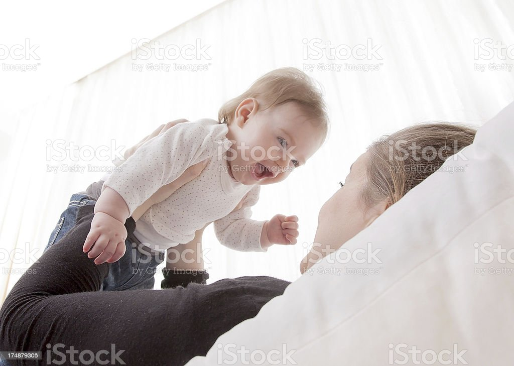 Daughter and young mother playing royalty-free stock photo