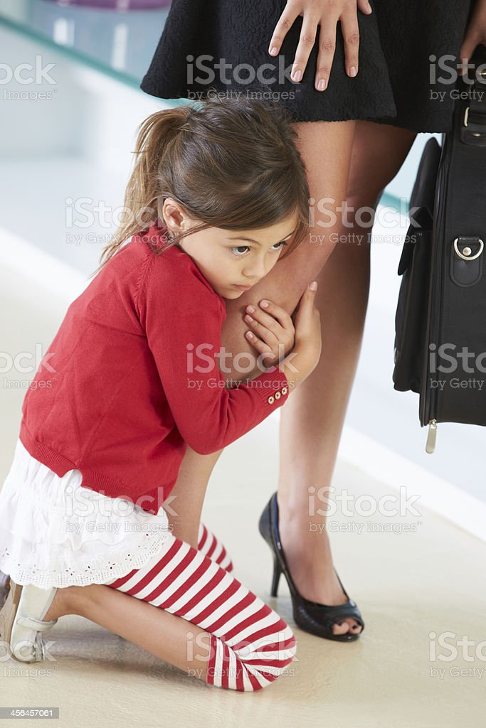Daughter Clinging To Mother's Leg stock photo