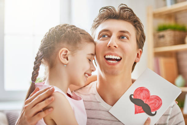 daughter congratulates dad - little girls giving head stock photos and pictures