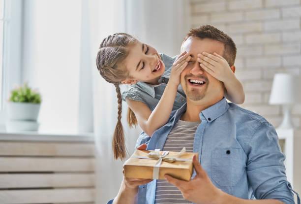 daughter congratulating dad stock photo