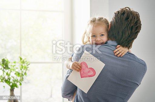 istock daughter congratulating dad 962420616