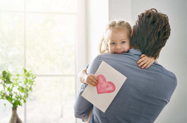 daughter congratulating dad - little girls giving head stock photos and pictures