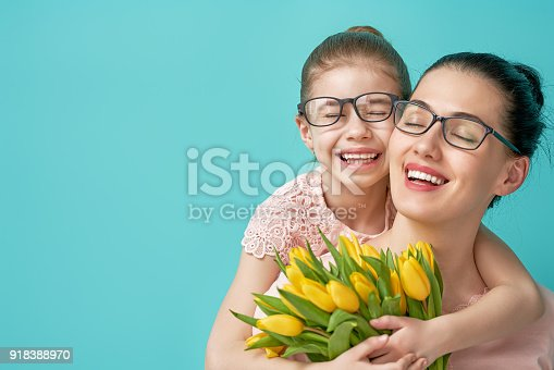 istock daughter congratulating mom 918388970