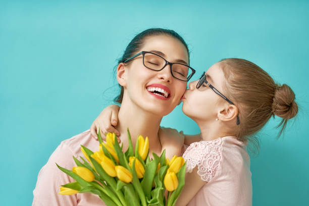 daughter congratulating mom - little girls giving head stock photos and pictures