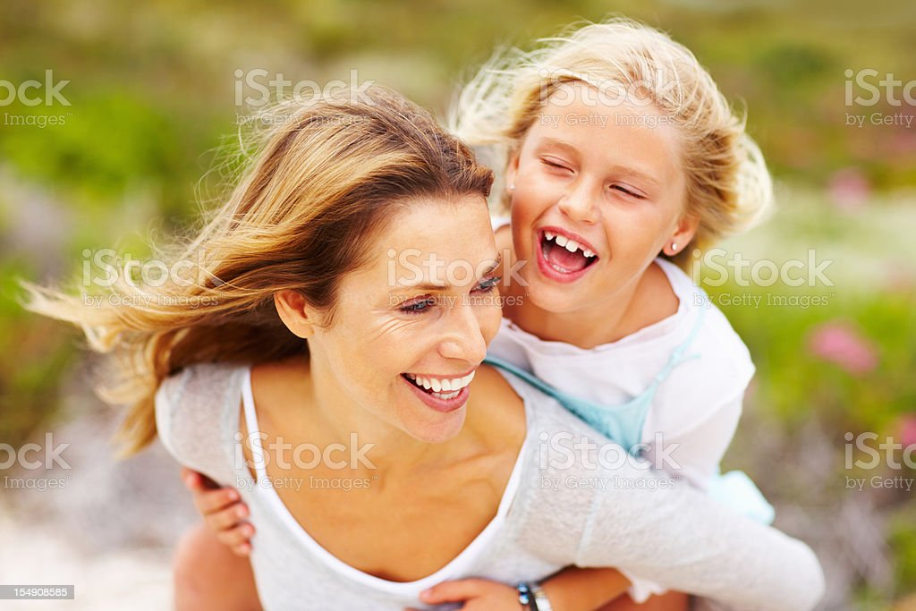Daughter enjoying piggyback ride royalty-free stock photo