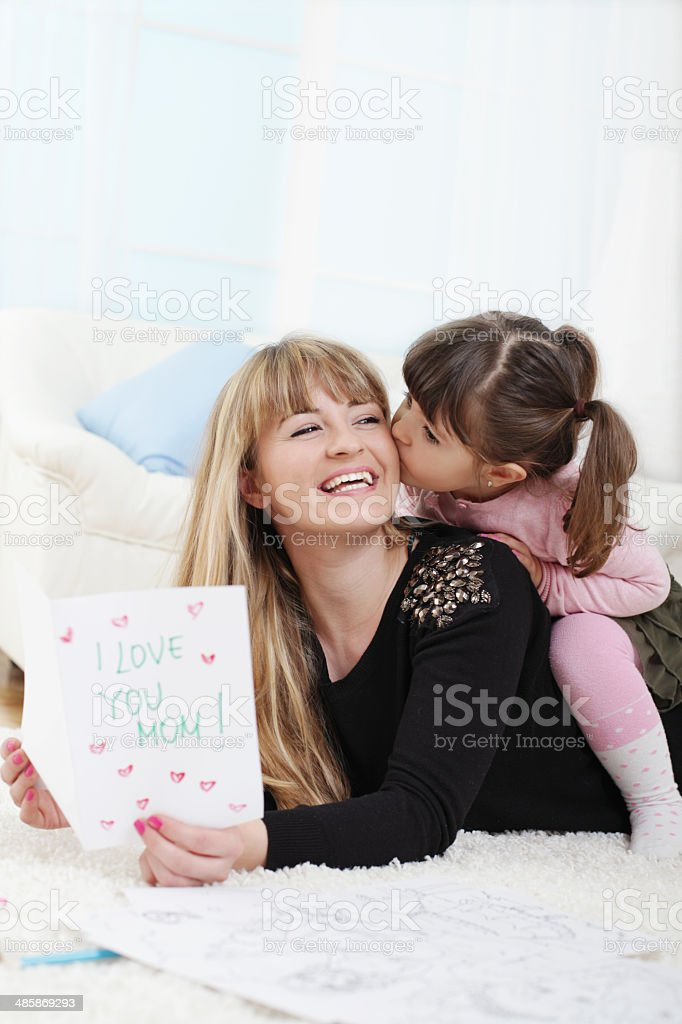 Daughter giving her mother a gift stock photo