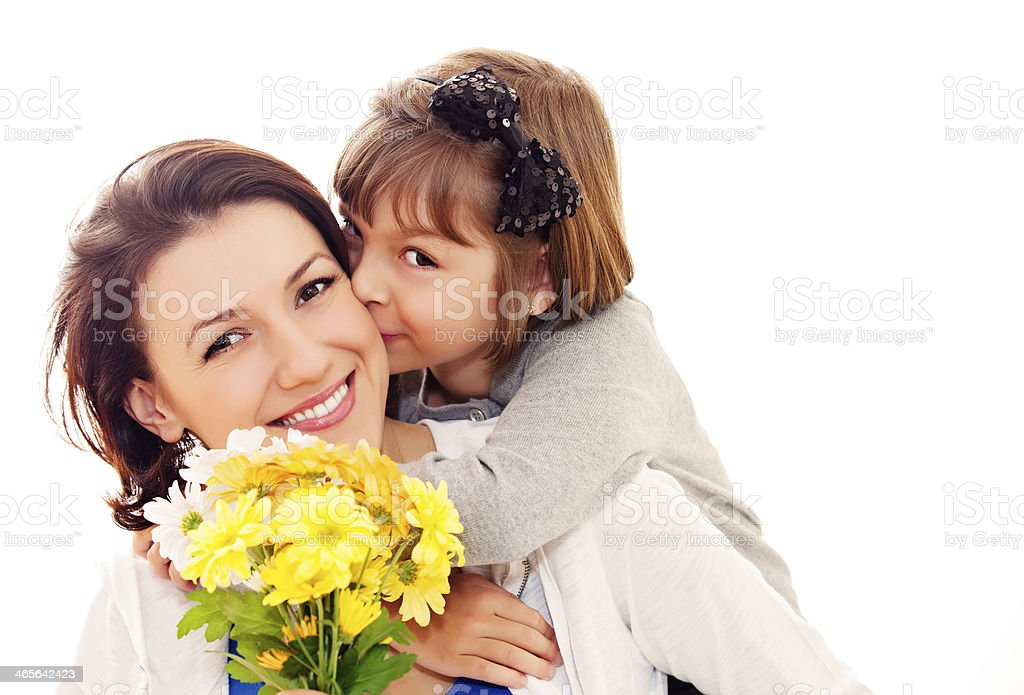 A daughter giving her mother flowers for Mother's Day stock photo