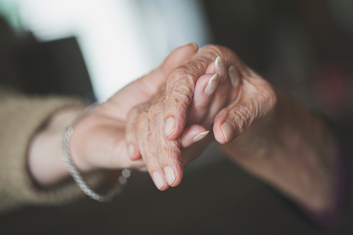istock Daughter holding hand of her old mother 840306994