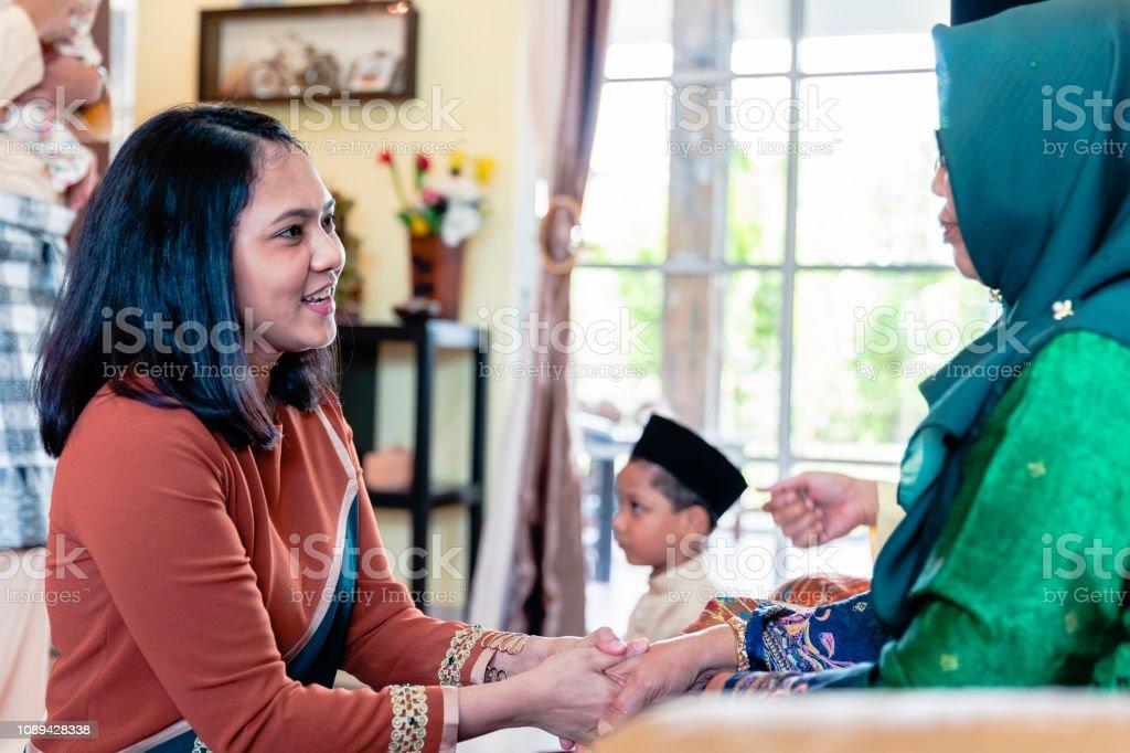 Daughter home for Hari Raya Aidilfitri stock photo