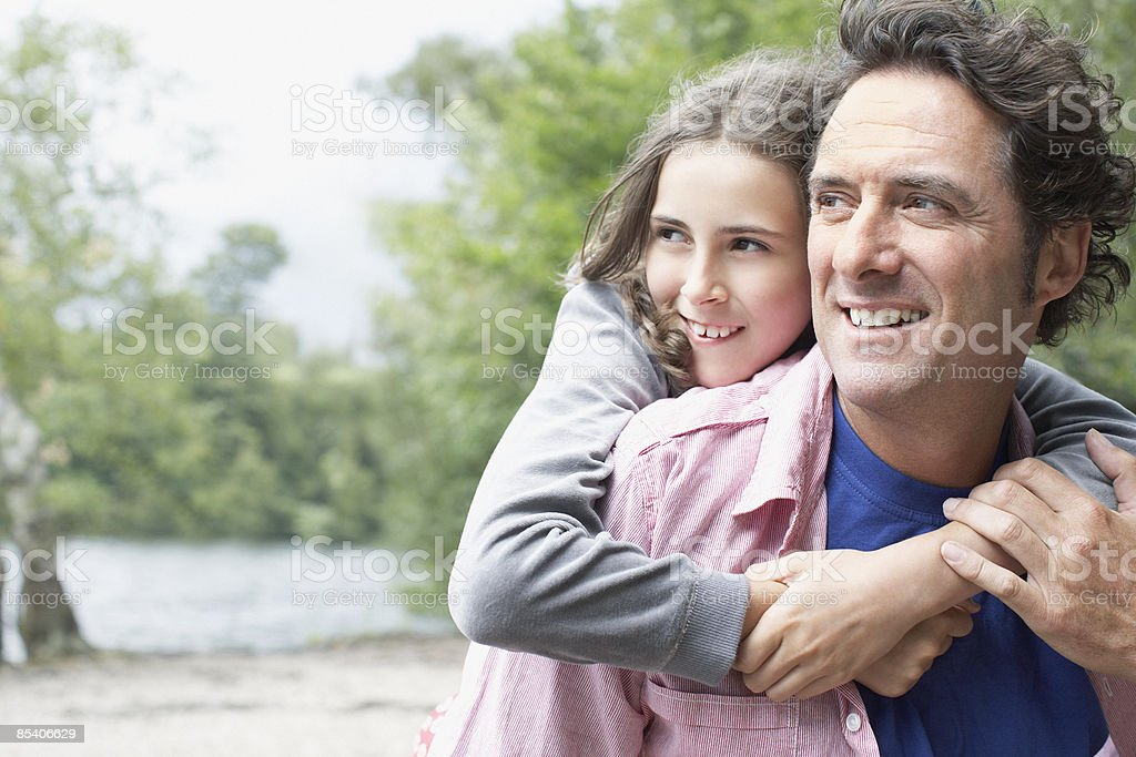 Daughter hugging father outdoors royalty-free stock photo