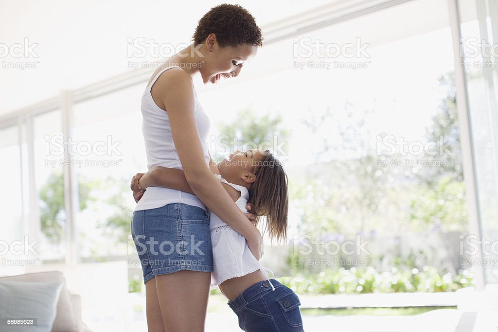 Daughter hugging mother 免版稅 stock photo