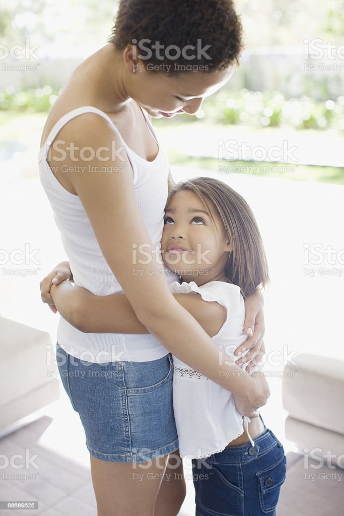 Daughter hugging mother royalty-free stock photo