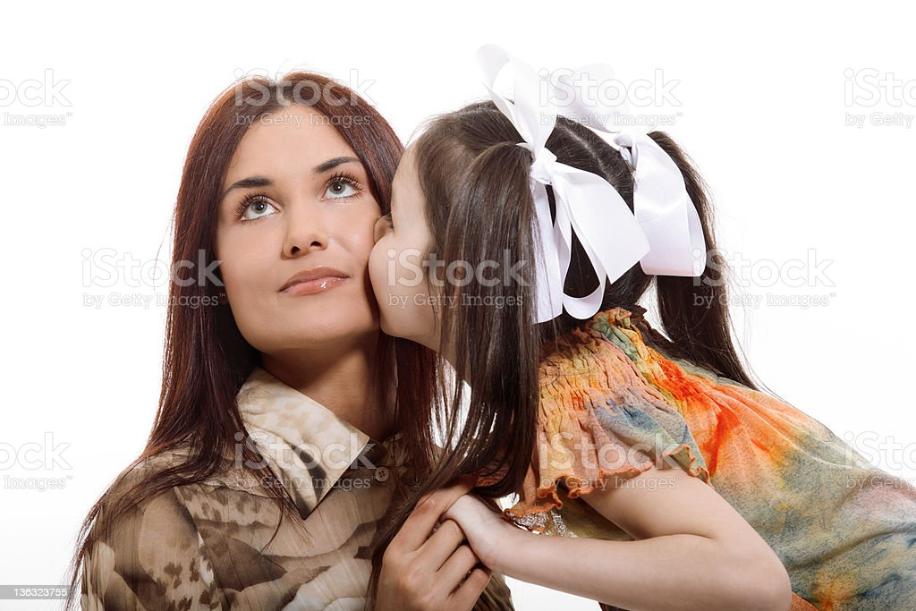Daughter kisses her mother stock photo