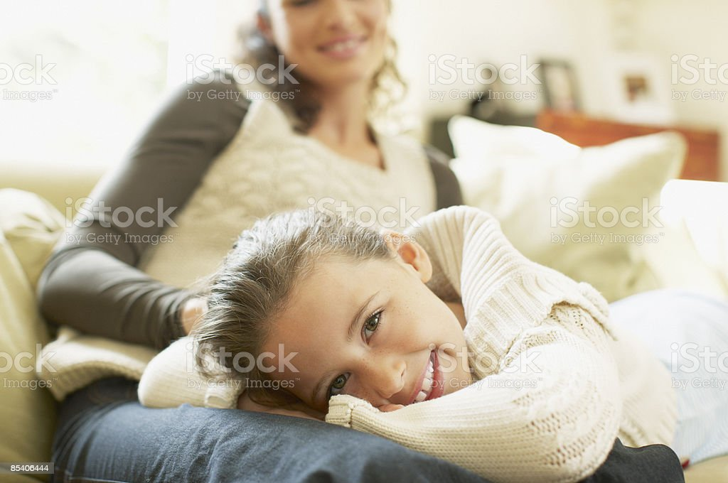 Daughter laying in mothers lap royalty-free stock photo