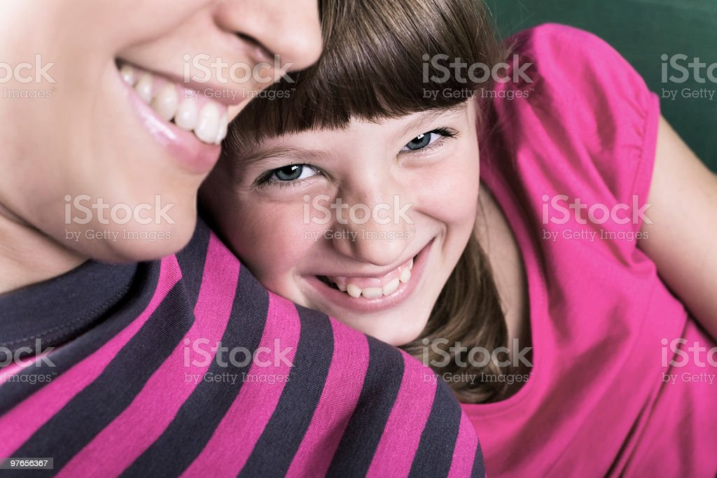 Daughter leaning on mom's shoulder royalty-free stock photo