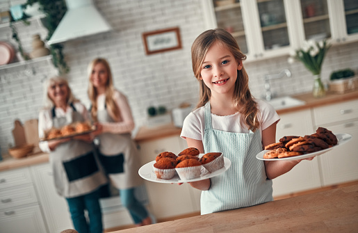 494086690 istock photo Daughter, mother and grandmother on kitchen 1135162909