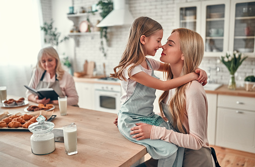 494086690 istock photo Daughter, mother and grandmother on kitchen 1135162970