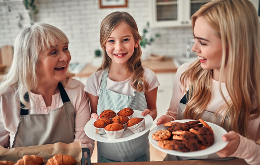 494086690 istock photo Daughter, mother and grandmother on kitchen 1135162971