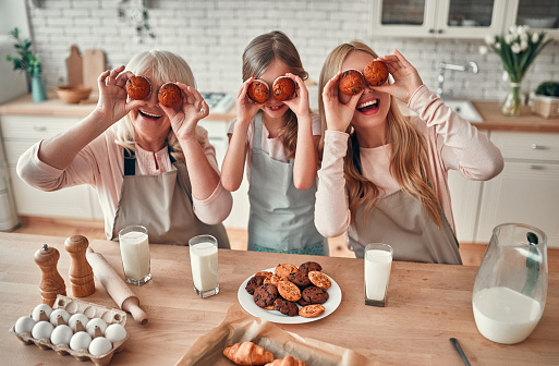 494086690 istock photo Daughter, mother and grandmother on kitchen 1135162998