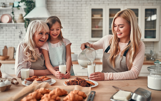 494086690 istock photo Daughter, mother and grandmother on kitchen 1135163028