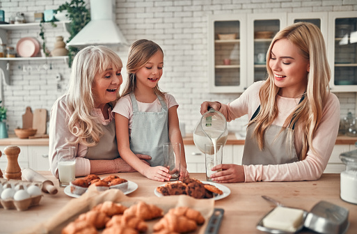 494086690 istock photo Daughter, mother and grandmother on kitchen 1135163074