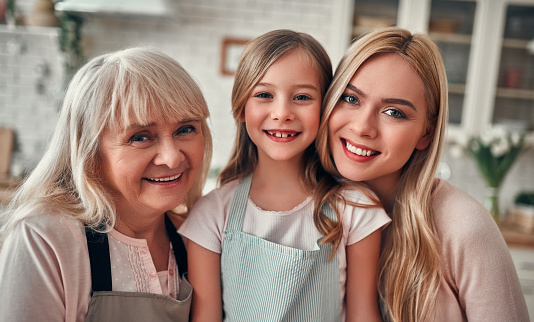 494086690 istock photo Daughter, mother and grandmother on kitchen 1135163101