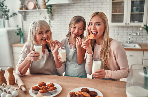 494086690 istock photo Daughter, mother and grandmother on kitchen 1135163114