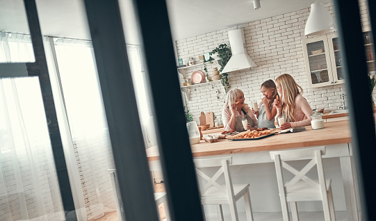 494086690 istock photo Daughter, mother and grandmother on kitchen 1135163137