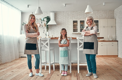 494086690 istock photo Daughter, mother and grandmother on kitchen 1135163153